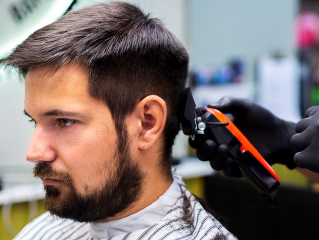 Sideways customer waiting for a haircut