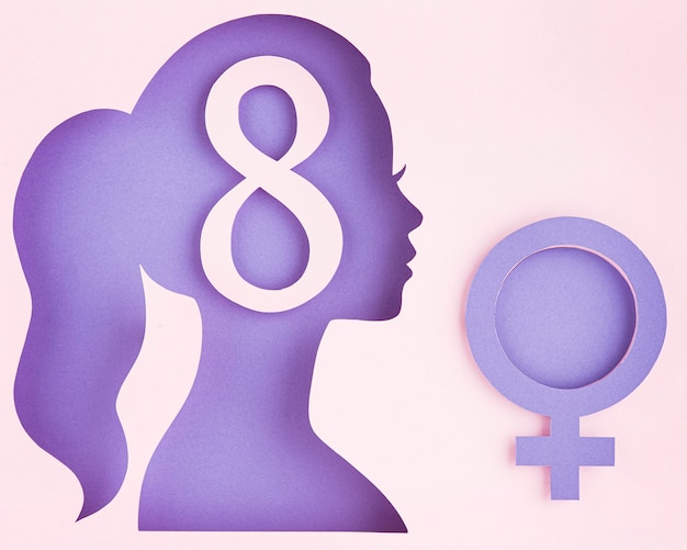 Sideways female paper figure and feminine symbol