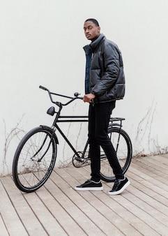 Sideways man and his bicycle
