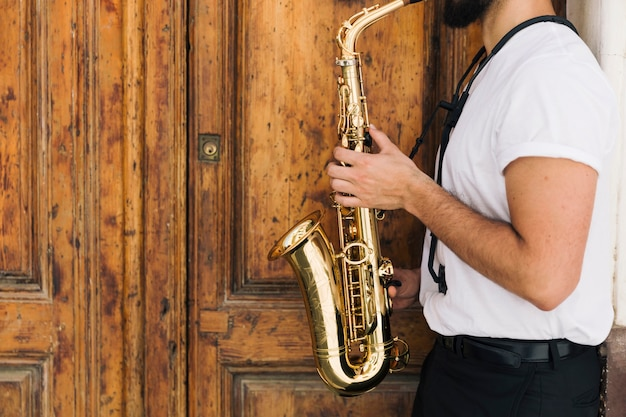 Sideways musician playing the saxophone