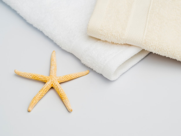 Sideways seastar next to towels