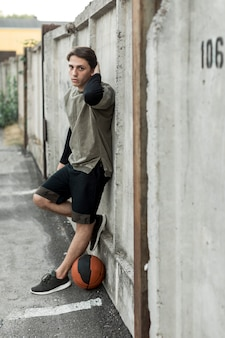 Sideways urban basketball player posing