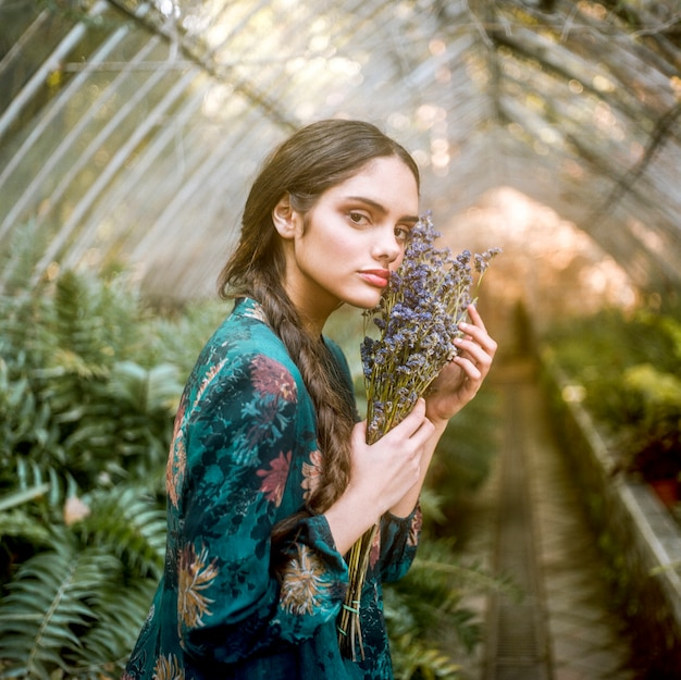 Sideways woman holding lavender flowers