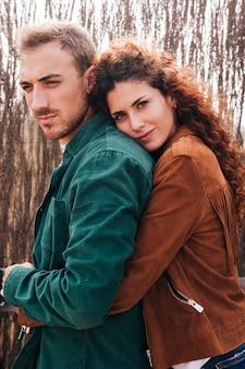 Sideways woman hugging man