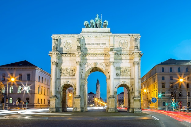 The siegestor in munich. this is a long exposure at dusk with traffic going around the arch