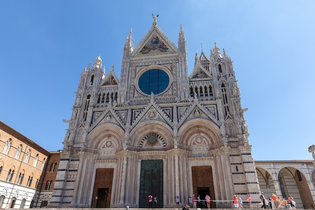 Siena, italy - june 28, 2018: panoramic facade of siena cathedral (duomo di siena) is a medieval church in siena, dedicated from its earliest days as a roman catholic marian church