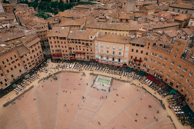 Siena, italy - june 28, 2018: panoramic view of piazza del campo is the principal public space of the historic center of siena from torre del mangia is a tower in city
