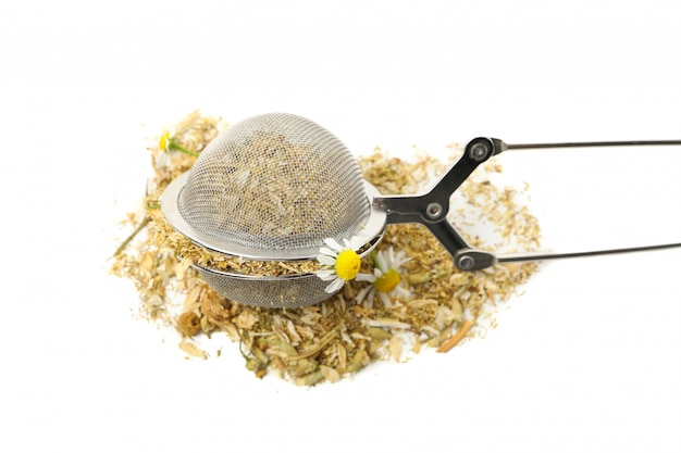 Sieve with dried chamomile isolated on white