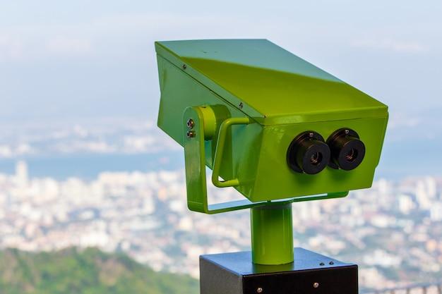 Sightseeing binoculars overlooking top view of georgetown, capital of penang island, malaysia