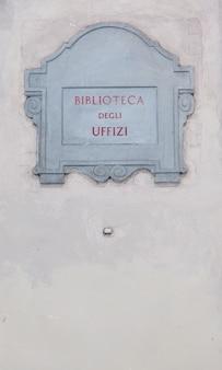 Sightseeing close to the main entrance of the biblioteca degli uffizi (uffizi's library), florence, italy