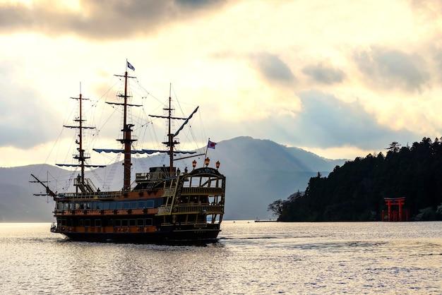 Sightseeing pirate ship on ashi lake with torii gate of hakone shrine