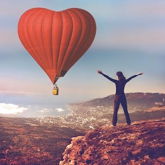 Sigle air balloon in blue sky