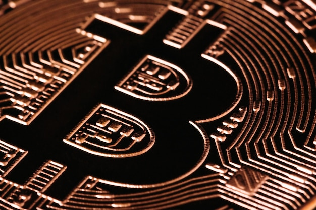 Sign bitcoin in gold close-up macro