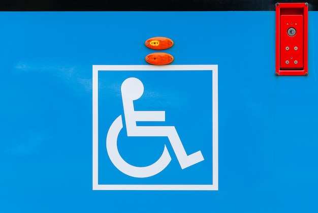 Sign for disabled at city tram side public transport accessibility