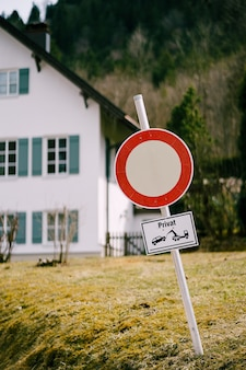 The sign is a white circle with red movement is forbidden a sign of private territory
