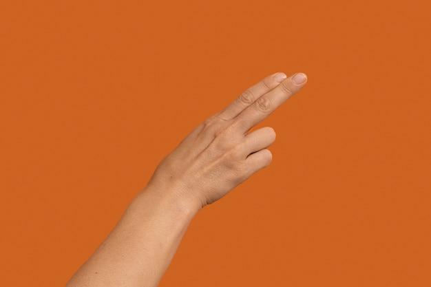 Simbolo della lingua dei segni isolato su orange