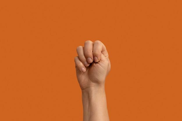 Sign language symbol isolated on orange
