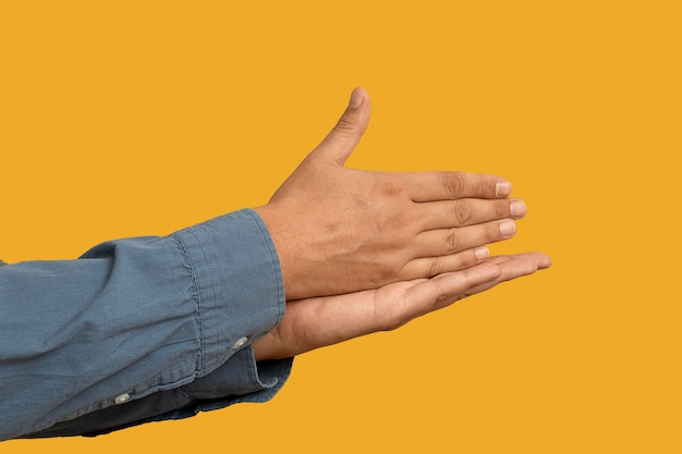 Sign language symbol isolated on yellow