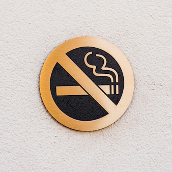 Sign no smoking on rough white surface