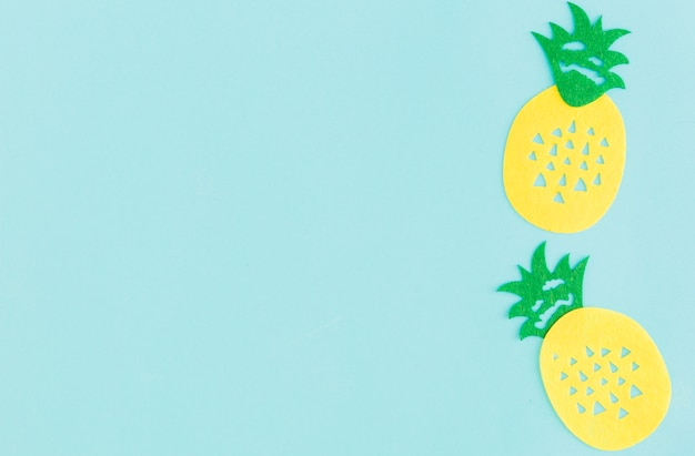 Sign of pineapple on light background