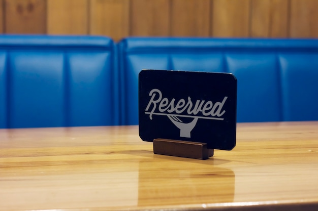 The sign reserved on the empty table in a cafe