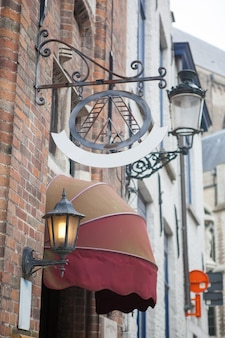 Sign saying hotel in a bruges street in belgium
