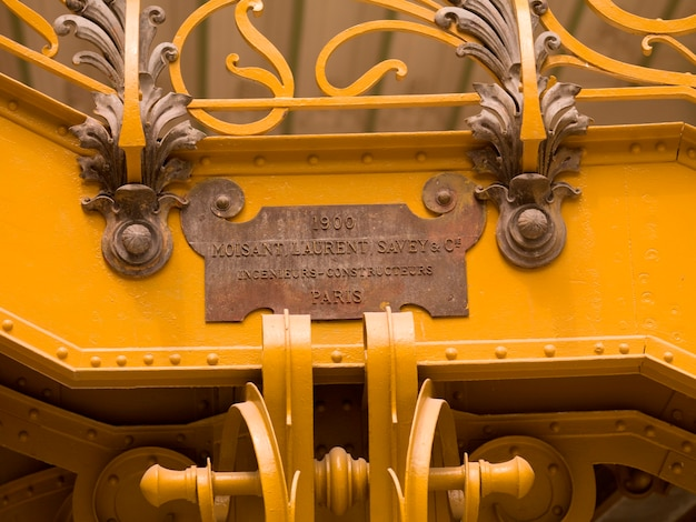Sign on side of staircase in the grand palace in paris france