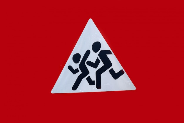 Sign signifying cautiously children, the image of children running across the road