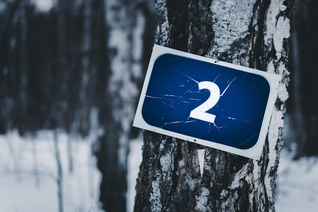 Sign on the tree with number two