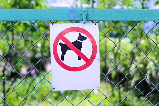 Sign walking of dogs prohibited on the  of fence