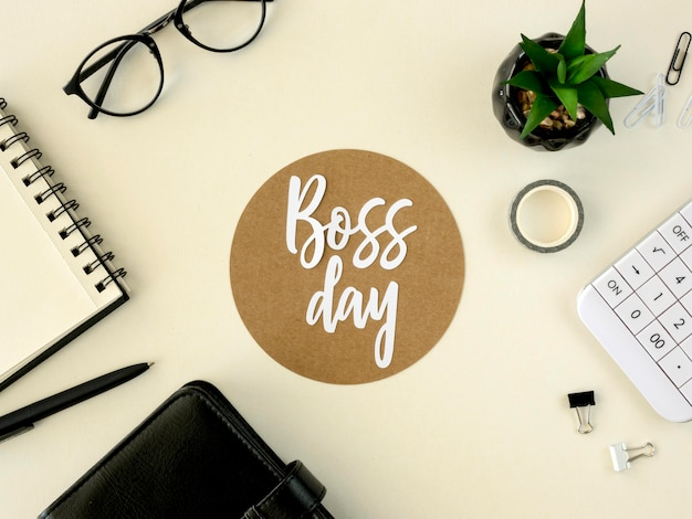 Sign with boss day on desk