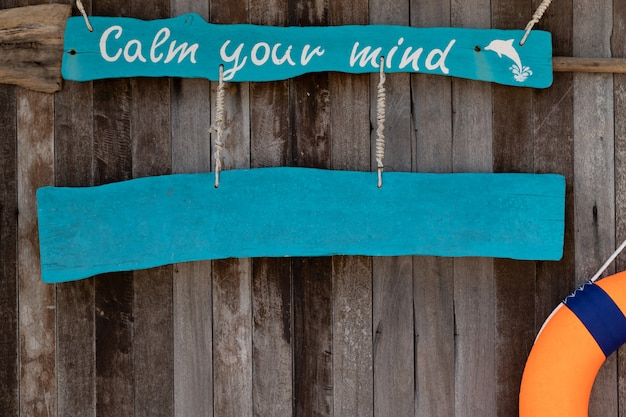 Sign with text calm your mind on old wooden background
