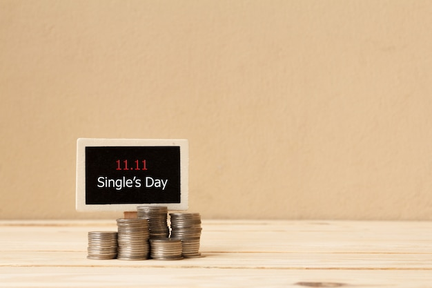 Signboard and coin stacks. online shopping of china. single's day sale concept.