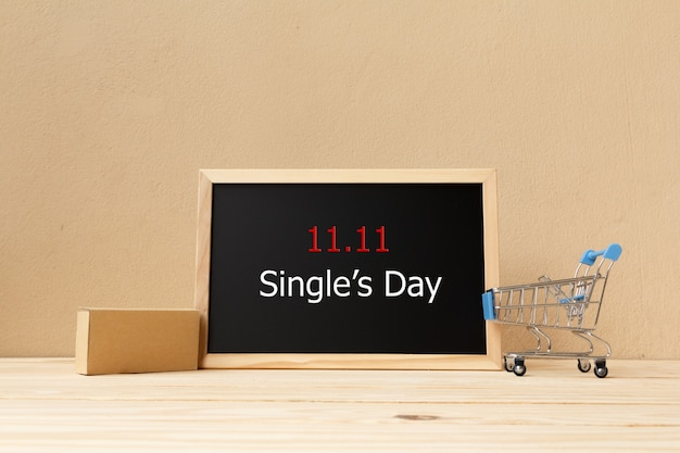 Signboard and shopping cart. online shopping of china. single's day sale concept.