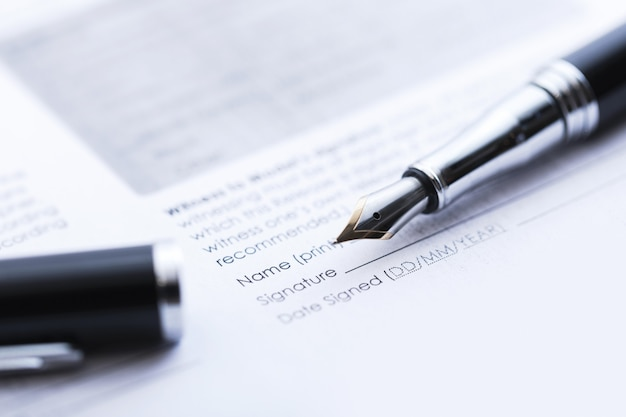 Signing the business contract. fountain pen and sheet document.