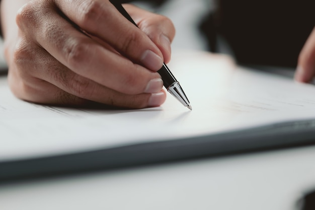 Signing contract businessman signing a contract investment professional document agreement