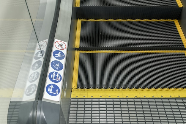 Signs on an escalator, warning signs
