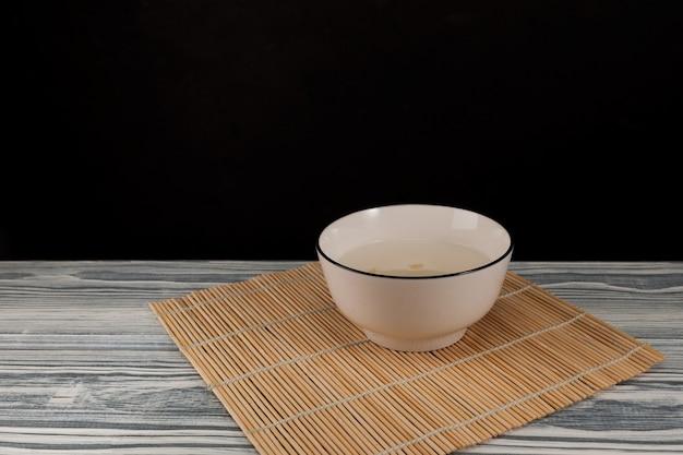 Sikhye traditional korean drink afternoon tea sweet rice beverage on dark