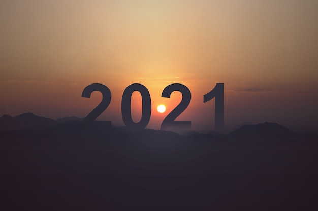 Silhouette of 2021 with a sunrise sky. happy new year 2021