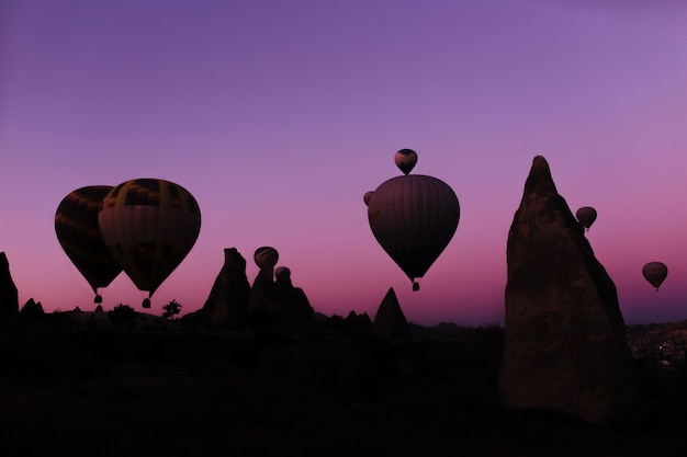 Silhouette of beautiful hot air balloons at sunrise in cappadocia