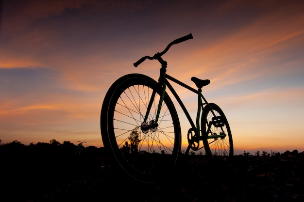 Silhouette bicycle in sunset