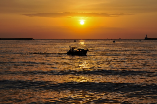 Silhouette of boats at sunset