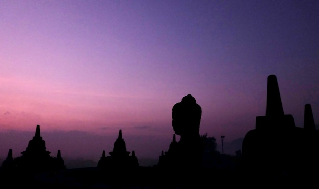 Silhouette of borobudur temple stupa in magelang central java indonesia buddhist temple