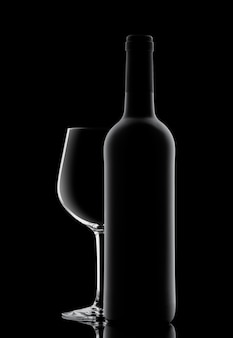 Silhouette of a bottle with wine on a black surface