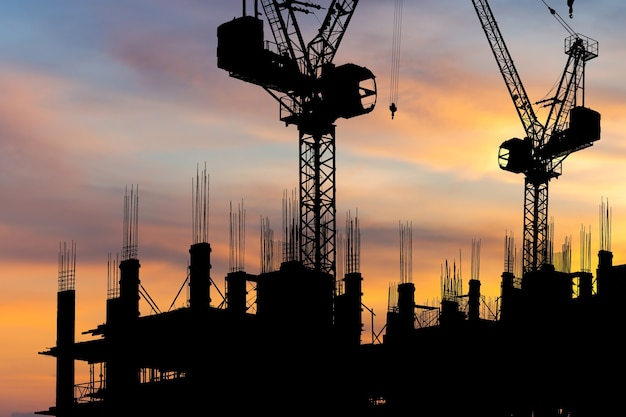 Silhouette of building site, construction site at sunset in evening time