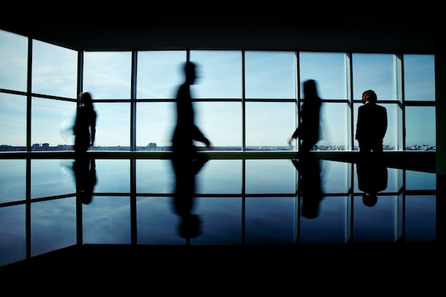 Silhouette of businesspeople rushing to work