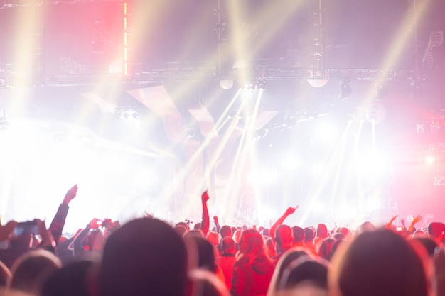 Silhouette of a concert crowd. the audience looks towards the stage. party people at a rock concert. musical party. musical show. group silhouette. young audience.