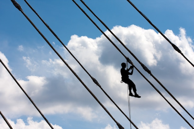 Silhouette of construction climber