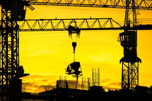 Silhouette construction site in sunset