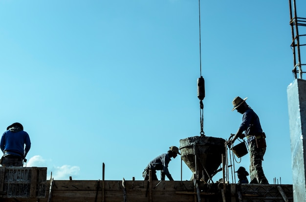 Silhouette of construction working concrete